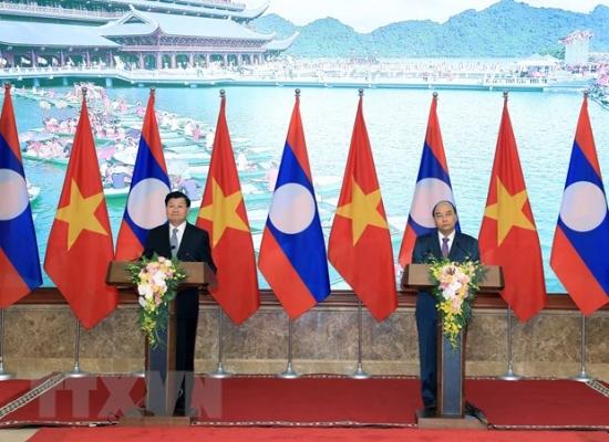 ttxvn-thu-tuong-nguyen-xuan-phuc-va-thu-tuong-thongloun-sisoulith-dong-chu-tri-ky-hop-lan-thu-42-uy-ban-lien-chinh-phu-ve-hop-tac-song-phuong-viet-4350525