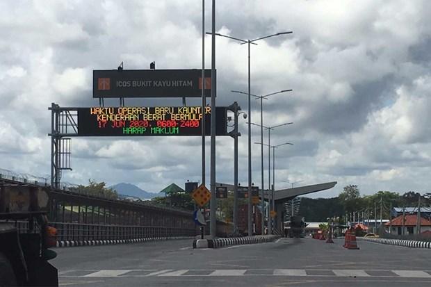 COVID-19: Malaysia đóng cửa một trạm kiểm soát biên giới với Thái Lan